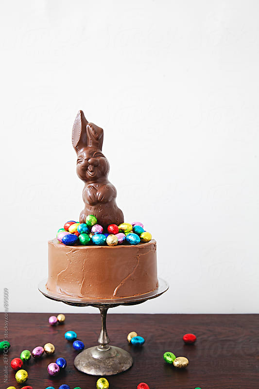 Decorated chocolate cake, with chocolate easter eggs and bunny by Natalie JEFFCOTT for Stocksy United
