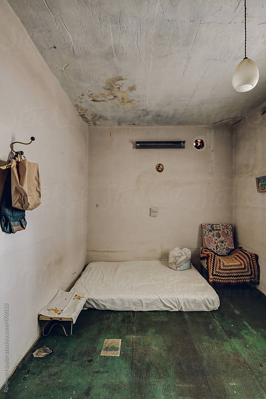 Shabby old room in house used by homeless person by Rowena Naylor for Stocksy United