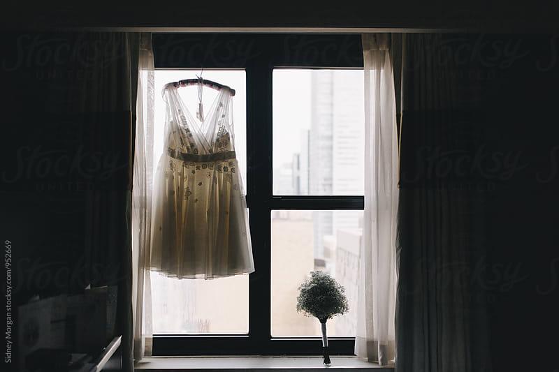 Wedding Dress in Window by Sidney Morgan for Stocksy United