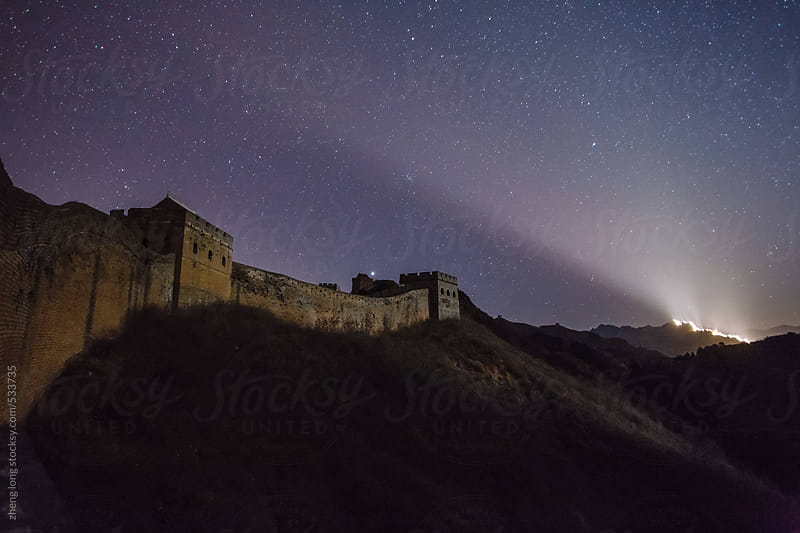 The Great Wall  under the starry by zheng long for Stocksy United