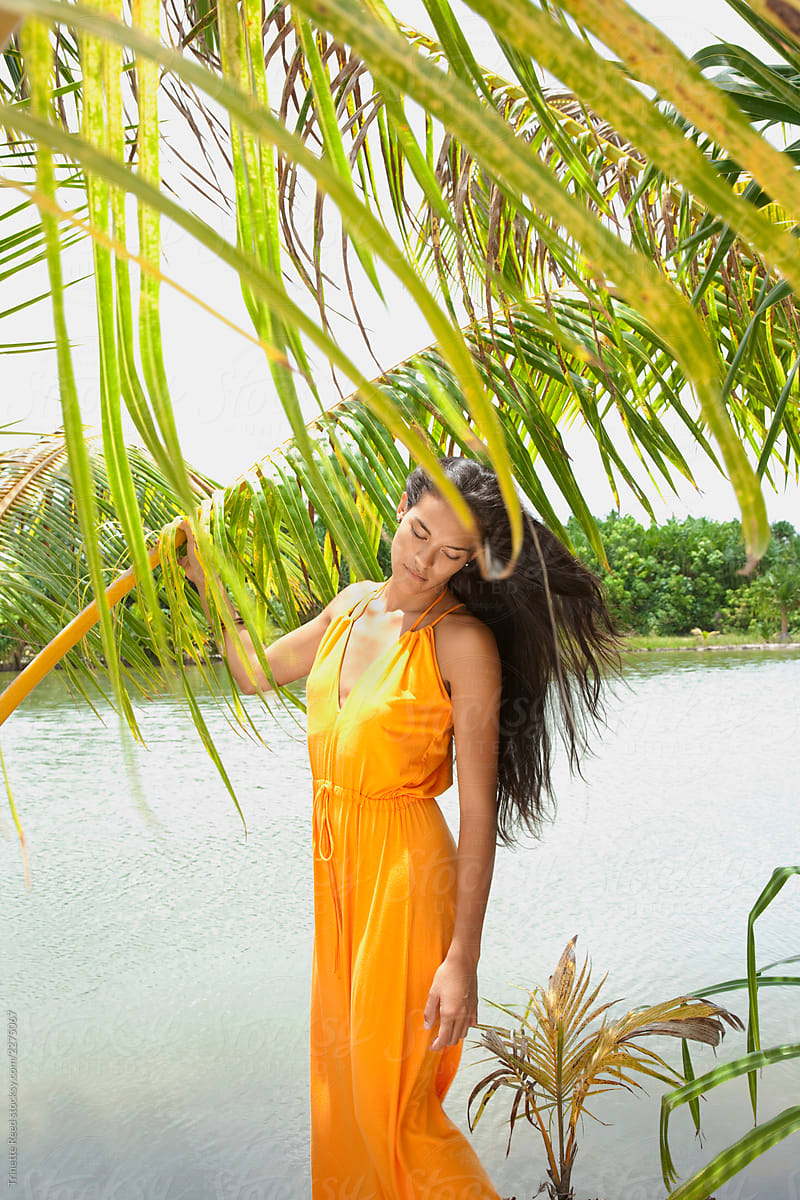 Beautiful Woman Under Tropical Palm Trees Stock Photo