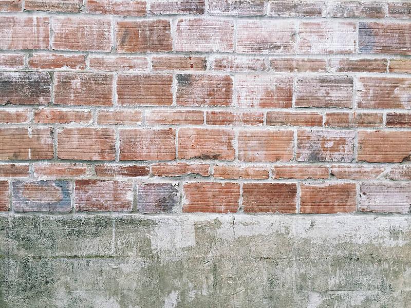 Detail of worn brick wall by Paul Edmondson for Stocksy United