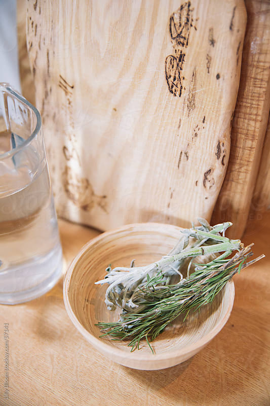 Wooden bowl with dried herbs by Lilly Bloom for Stocksy United