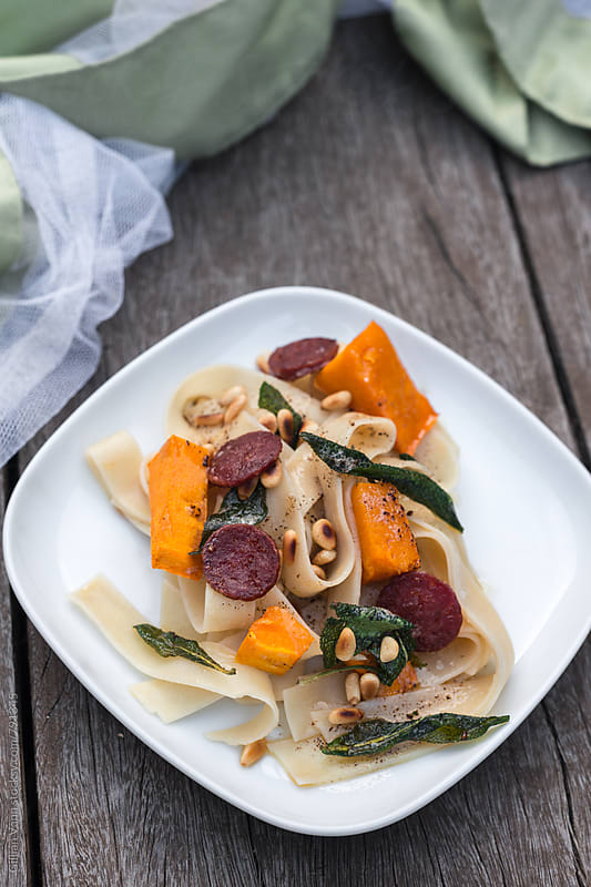 pappardelle with roasted pumpkin, burnt butter with sage, topped with pine nuts by Gillian Vann for Stocksy United