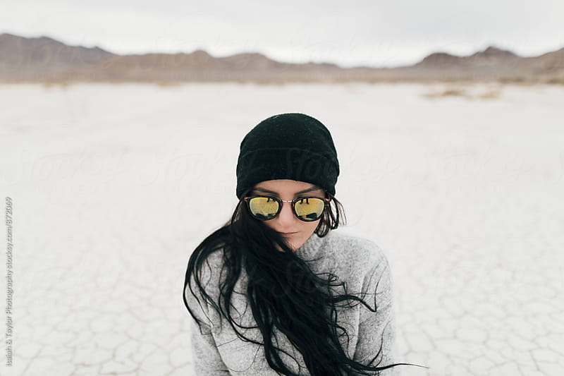 Young woman in desert by Isaiah & Taylor Photography for Stocksy United