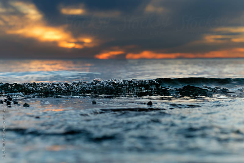 Surface Level shot of a Small Wave at Sunset by Gary Radler Photography for Stocksy United