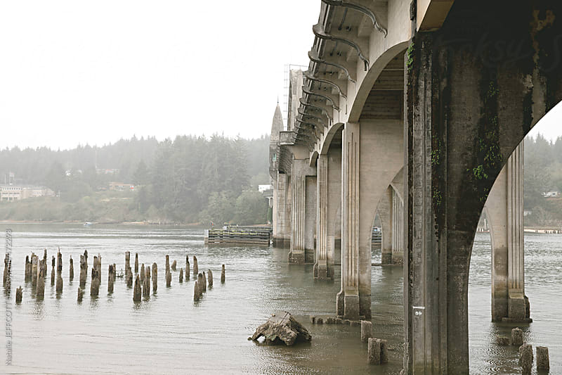 view from below the Siuslaw bridge in Florence Oregon by Natalie JEFFCOTT for Stocksy United