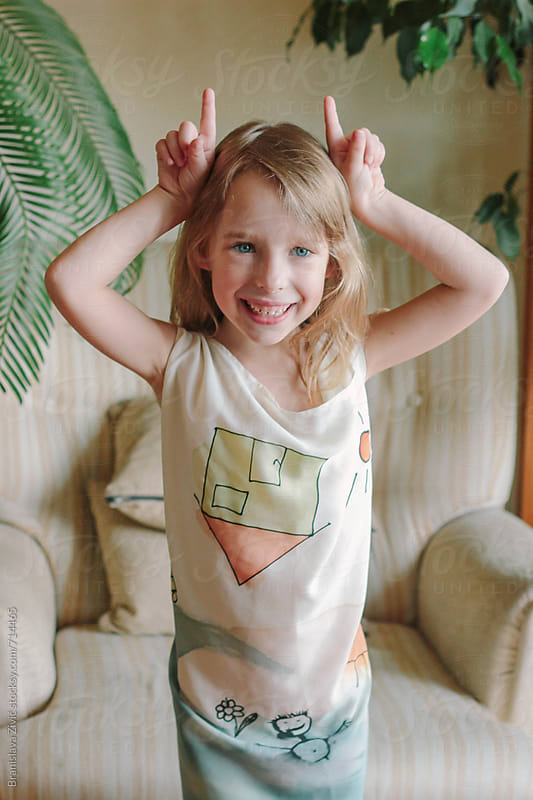 Portrait of a cute little girl having fun at her home by Branislava Živić for Stocksy United