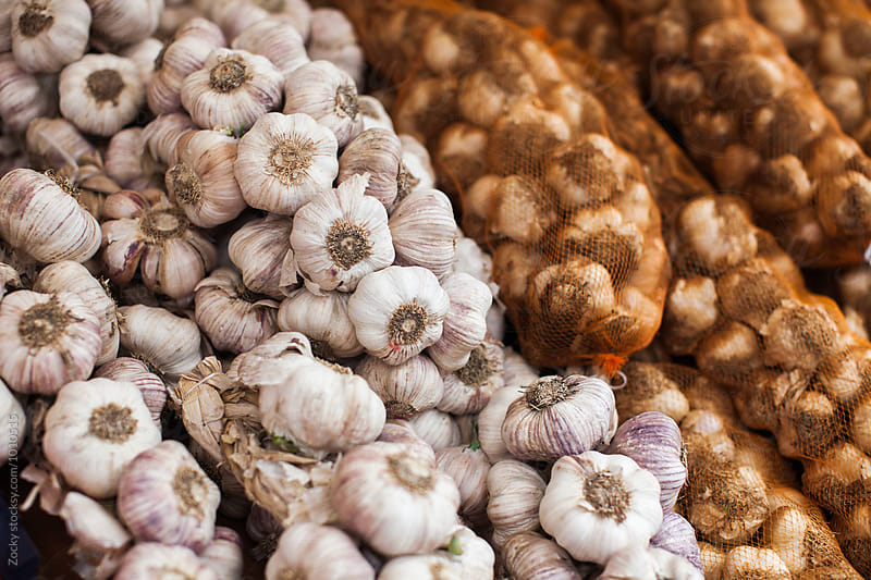 Garlic at a market by Zocky for Stocksy United