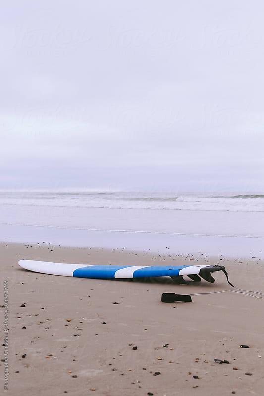 Surf board on beach by Photographer Christian B for Stocksy United