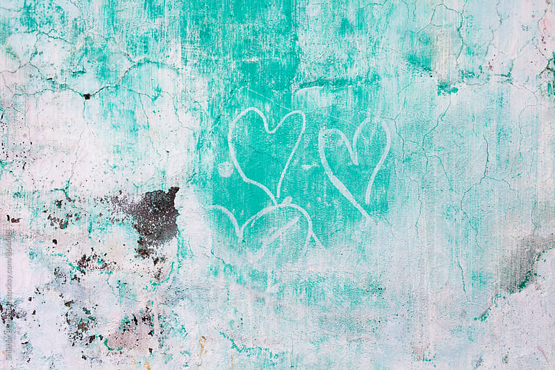 Old weathered wall with fading hearts. by Shikhar Bhattarai for Stocksy United