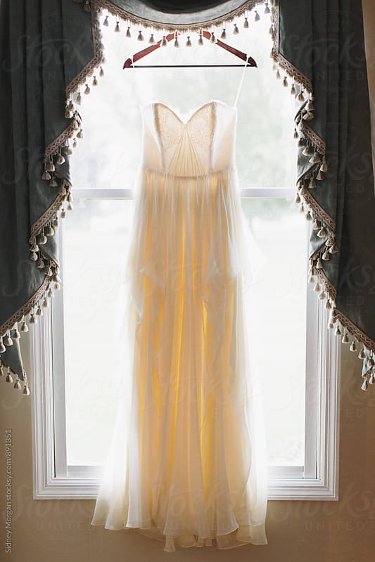 Wedding Dress in Window by Sidney Morgan for Stocksy United