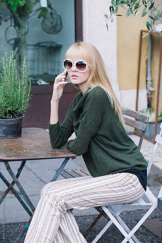 Stylish young woman having a phone call by Alberto Bogo for Stocksy United