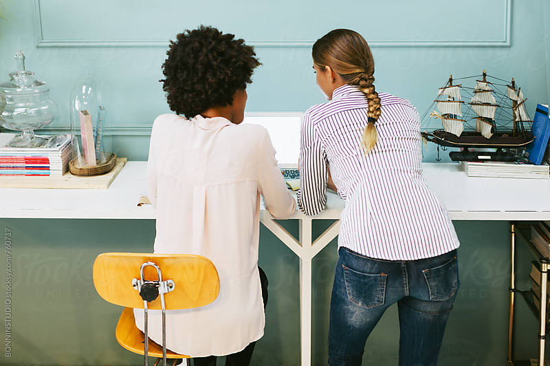 Back view of a businesswomen working at office. by BONNINSTUDIO for Stocksy United