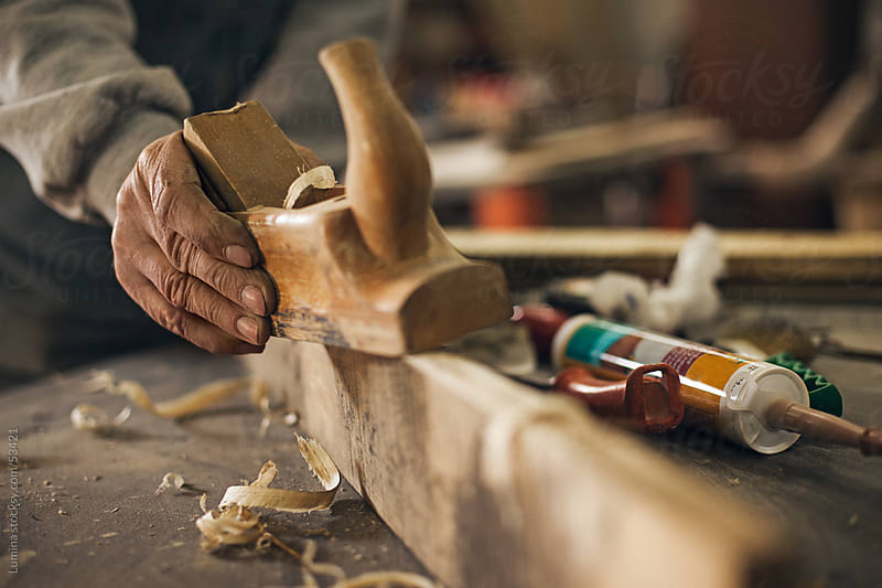 Carpenter's Hands Smoothing a Plank by Lumina for Stocksy United