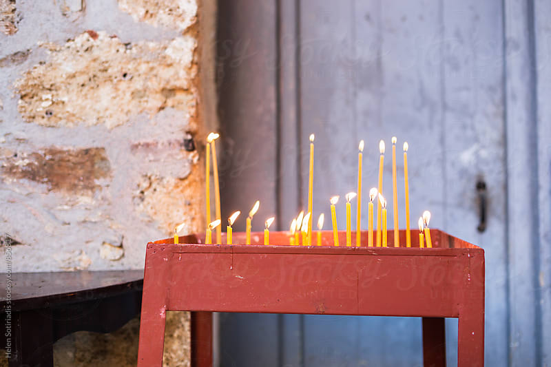 Candles at a Monastery by Helen Sotiriadis for Stocksy United