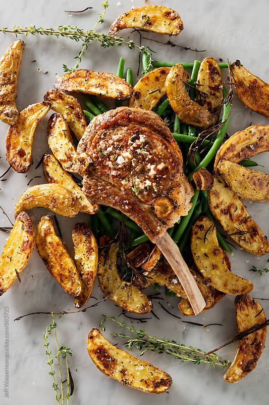 Grilled Veal Chop with Fingerling Potatoes and Green Beans  by Jeff Wasserman for Stocksy United