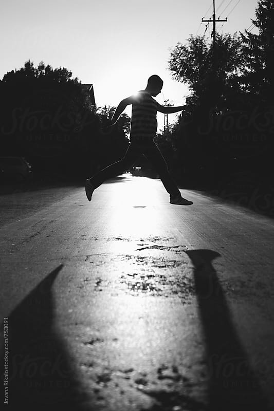 Man jumping silhouette by Jovana Rikalo for Stocksy United