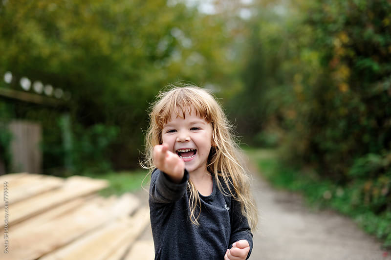 Laughing little girl by Svetlana Shchemeleva for Stocksy United