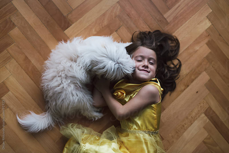 Girl and a dog friendship by Dejan Ristovski for Stocksy United