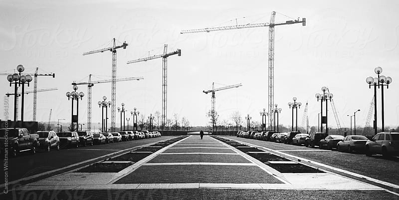 L'Enfant Plaza with tower cranes in the distance  by Cameron Whitman for Stocksy United
