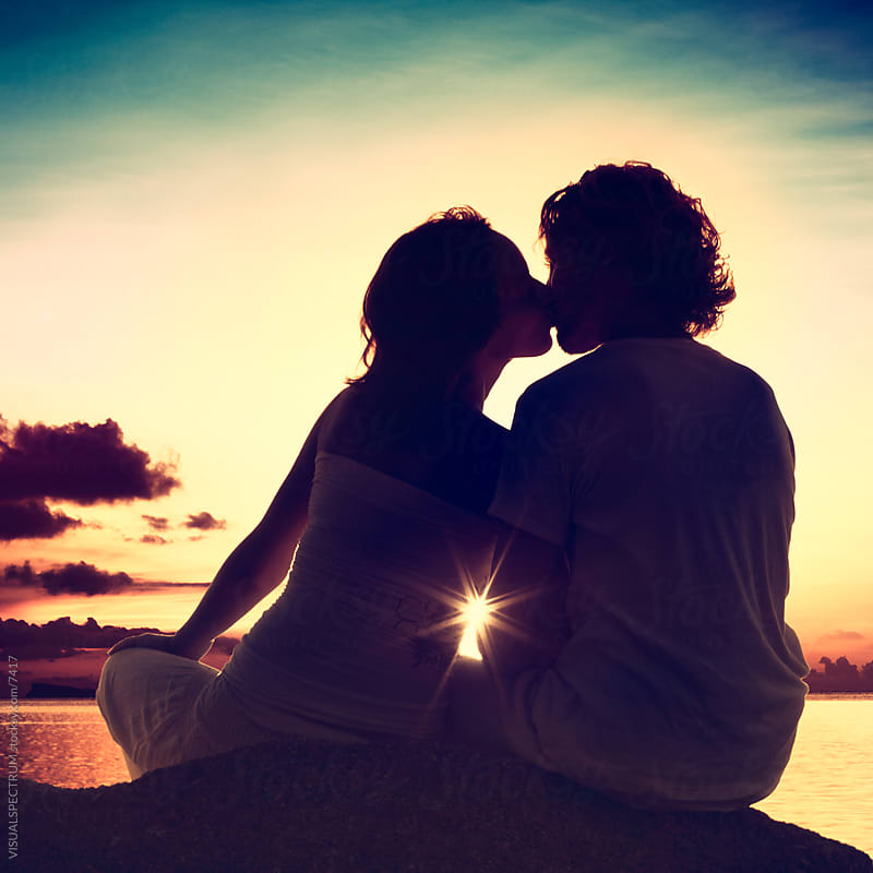 Lovers Kissing at Sunset by VISUALSPECTRUM for Stocksy United