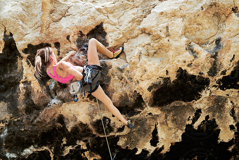 back view of climber ascending the cliff by Guille Faingold for Stocksy United