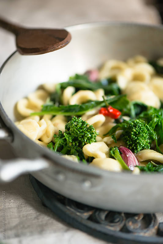 orecchiette with turnip greens by Laura Adani for Stocksy United