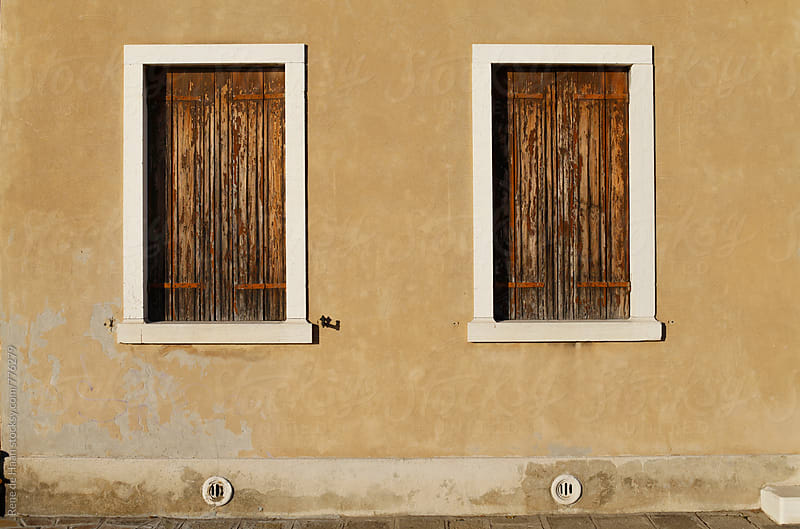 two windows with blinds in old house in Venice, Italy by Rene de Haan for Stocksy United