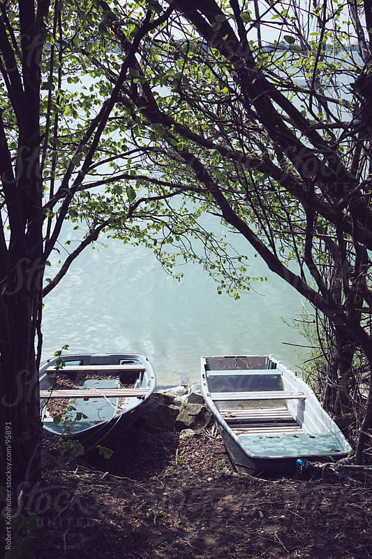 Two boats lying at a lake in germany by Robert Kohlhuber for Stocksy United