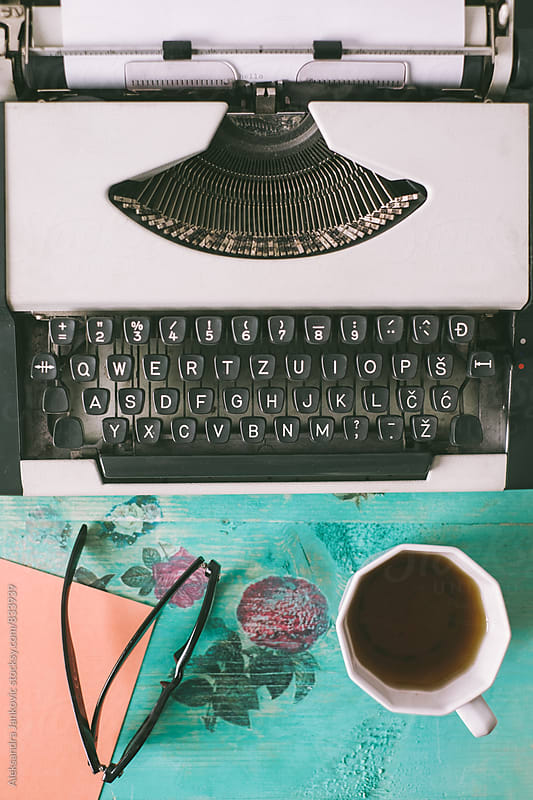 Typewriter and Coffee on the Floral Vintage Table by Aleksandra Jankovic for Stocksy United