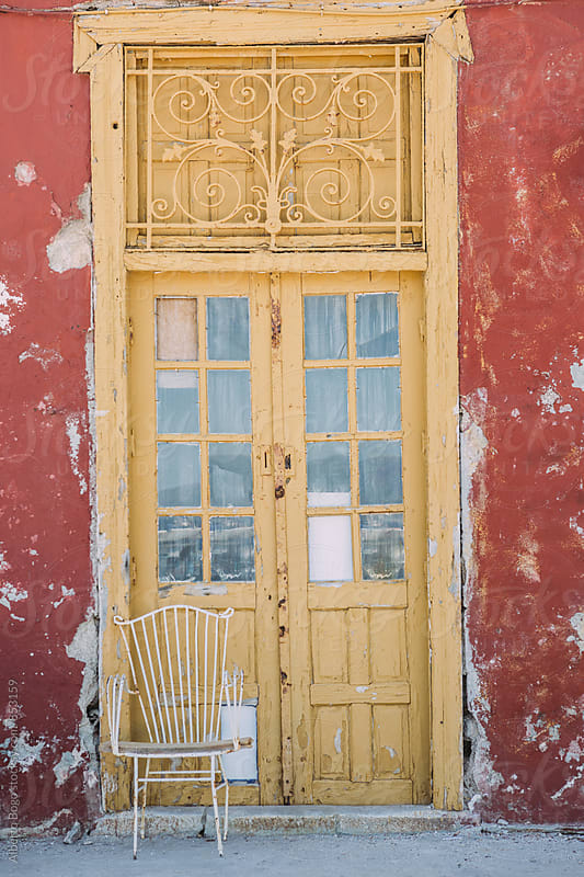 Old door in Hydra island, Greece. by Alberto Bogo for Stocksy United