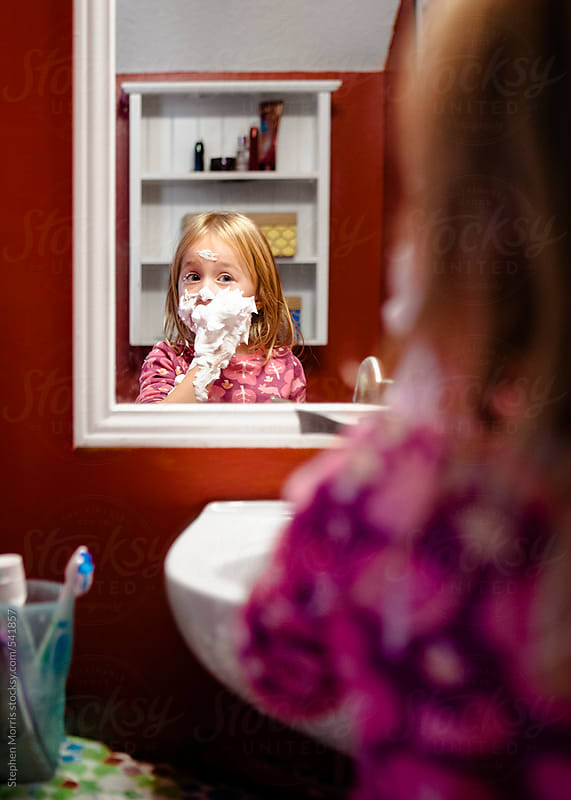 Little girl playing with shaving cream by Stephen Morris for Stocksy United