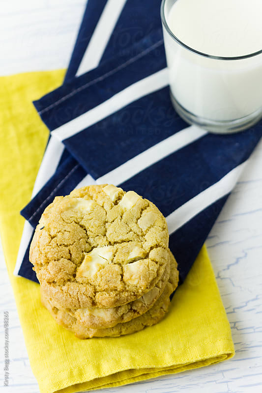 White Chocolate Cookies and milk vertical by Kirsty Begg for Stocksy United