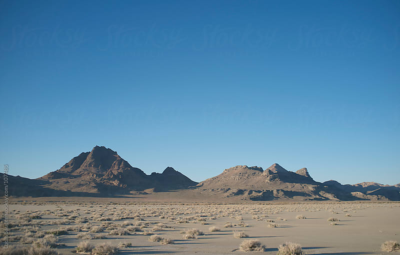 Mountin Hills in the Salt Flats of Utah by Lucas Saugen for Stocksy United