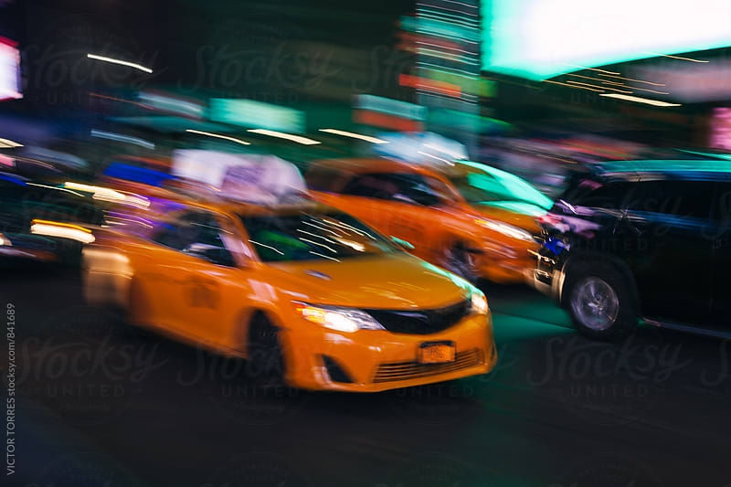 Yellow Taxi in Manhattan, New York by VICTOR TORRES for Stocksy United