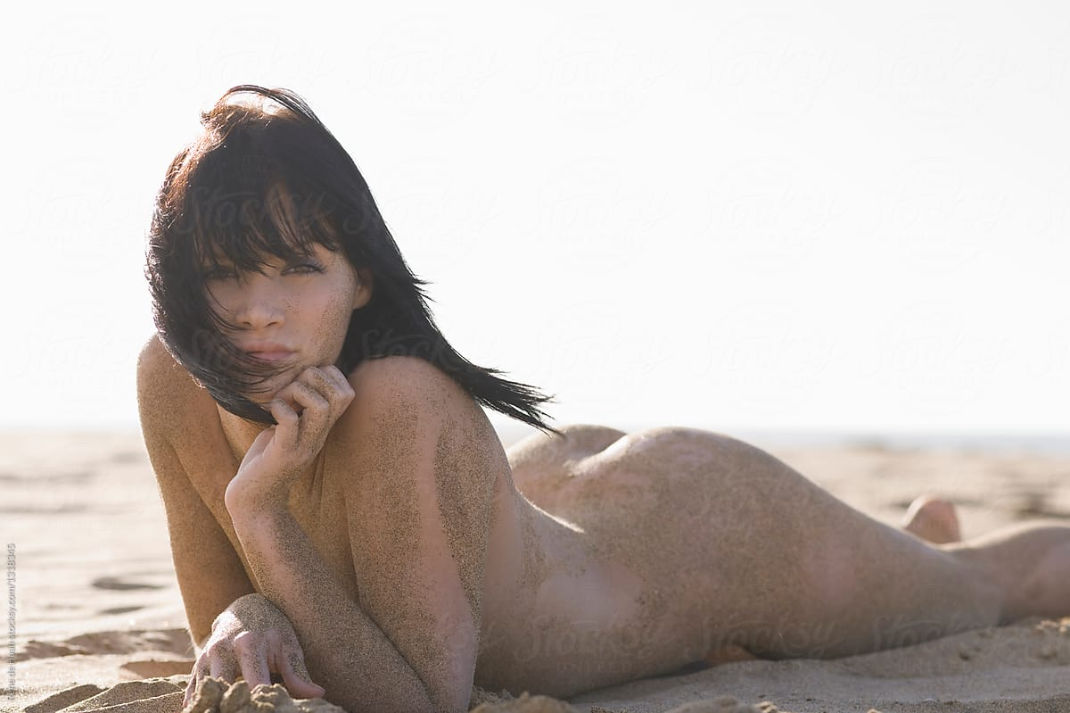Nude Young Woman Lying On Beach  Stocksy United-6222