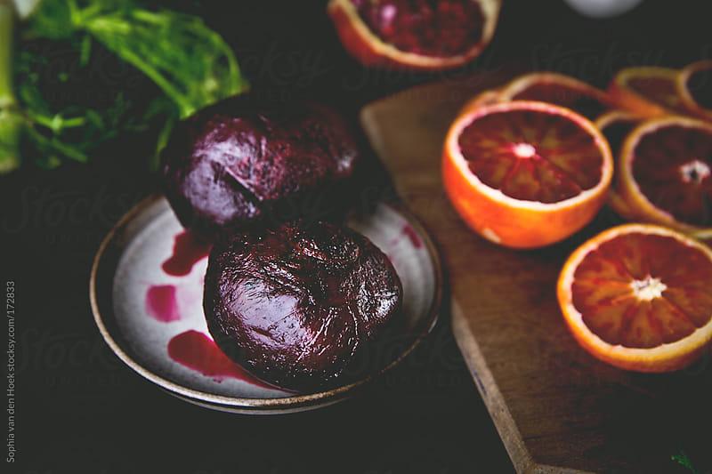 Beets and blood orange by Sophia van den Hoek for Stocksy United