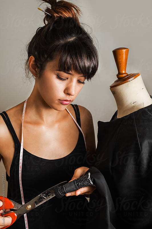 portrait of young fashion designer working with textile mannequin by Marko Milanovic for Stocksy United
