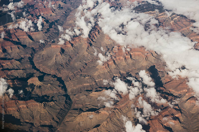 Canyon and river in Arizona from above in an airplane window by Daring Wanderer for Stocksy United