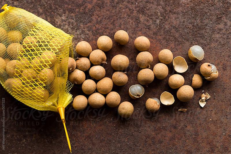 Lonan Fruit Spilling From Mesh Bag by Jeff Wasserman for Stocksy United