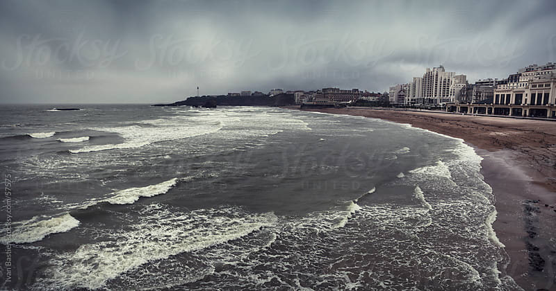 Biarritz beach on a cloudy day in Pays Basque, France by Ivan Bastien for Stocksy United