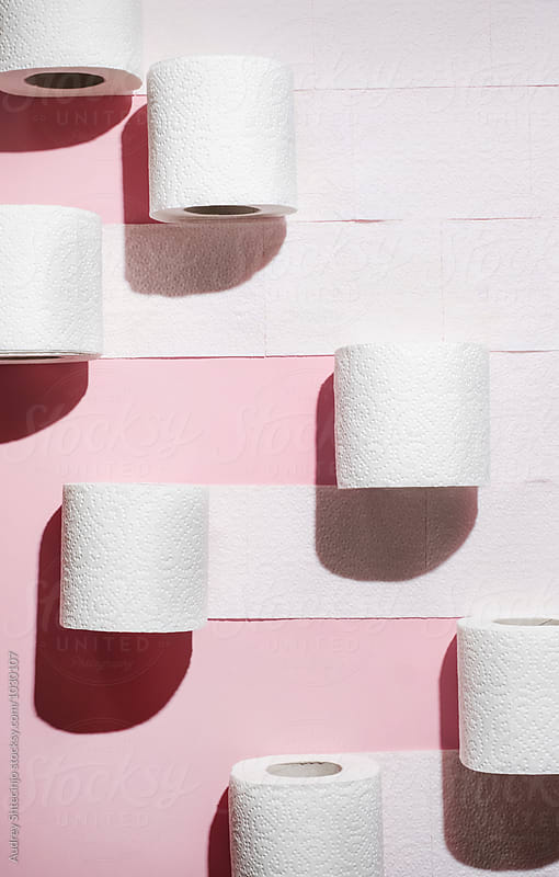 Toilet paper rolls on pink background. by Marko Milanovic for Stocksy United