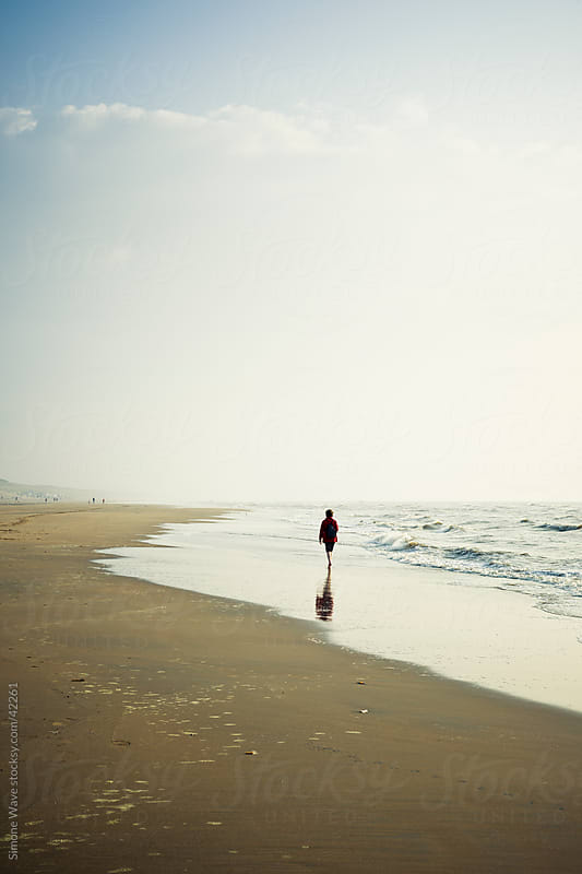 Person walking on the beach by GIC for Stocksy United