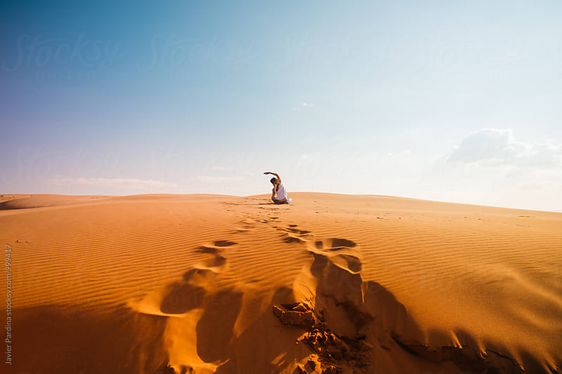 Woman enjoying on the desert by Javier Pardina for Stocksy United