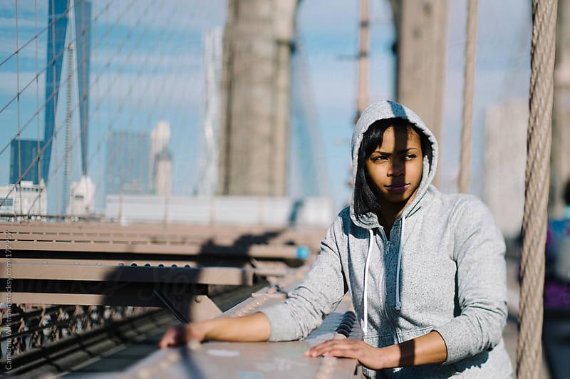 New Yorker portrait Brooklyn Bridge by Cameron Whitman for Stocksy United