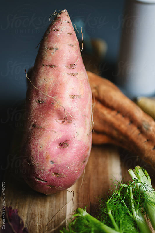 A beautiful sweet potato. by Darren Muir for Stocksy United