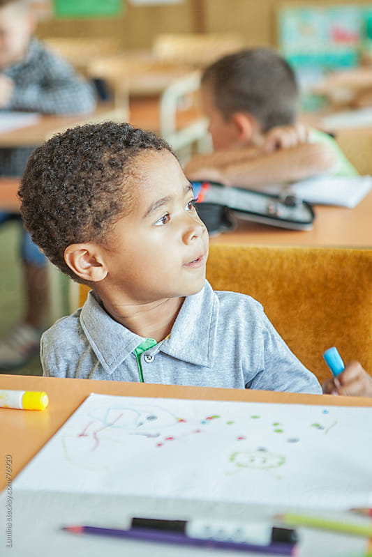 African Schoolboy in Class by Lumina for Stocksy United