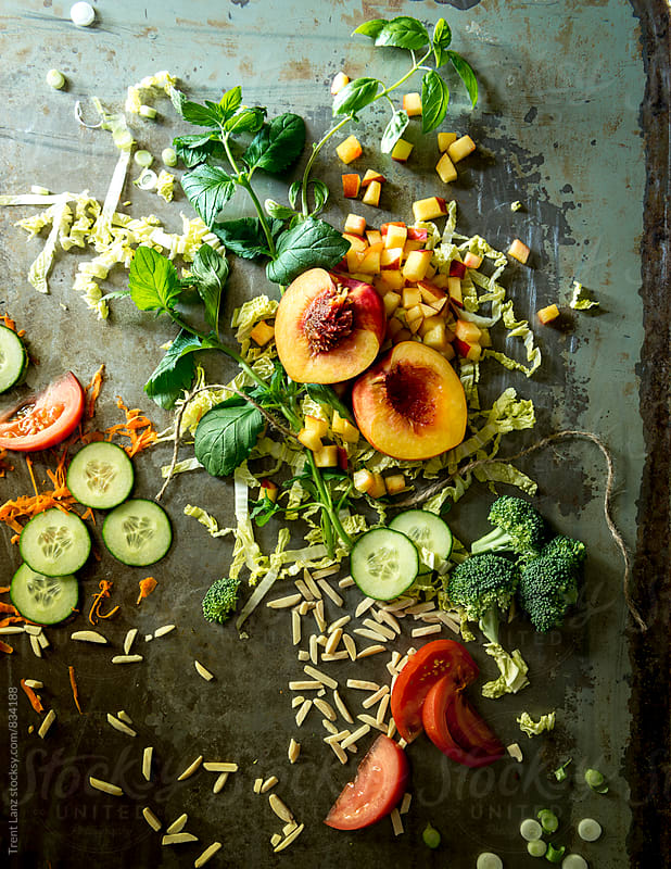 Paleo chopped nectarine summer salad with cucumber, broccoli & tomato by Trent Lanz for Stocksy United