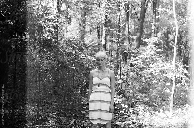 A portrait of a blond woman in the forest by Anna Malgina for Stocksy United